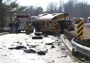 18-wheeler & school bus highway collision with injuries and fatality
